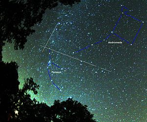 Two perseids meteors and their radiant (crossi...