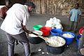 Le Directeur du BCNUDH, Jose Maria Aranaz , aide à préparer la nourriture des ex-combattants à Kamina (19460715542).jpg
