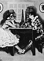 """Leoncavallo - Pagliacci - Columbine and Harlequin at supper - From """"The Great Operas"""" by J. Cuthbert Hadden - The Victrola book of the opera.jpg"""