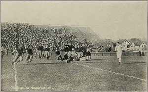 Lewie Hardage - Circling left end against Michigan, 1911.
