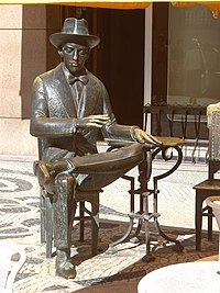 Bronze statue of poet Fernando Pessoa in the Café A Brasileira, in the Chiado neighbourhood.