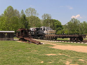 Little River Railroad (Tennessee) - The Little River Railroad and Lumber Company Museum in Townsend, Tennessee. The red machine on the left is a logging skidder, used to load logs onto flat cars. A 70-ton Shay engine, used to pull a typical logging railroad, is in the back in the center. A railroad flatcar, which carried the logs, is on the right.
