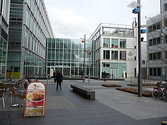 White City Place - BBC Broadcast Centre and Energy Centre in 2010. The One Show was broadcast from a studio in Energy Centre until 2013. The Olympic Rings mark the finishing line of the 1908 Olympic marathon.