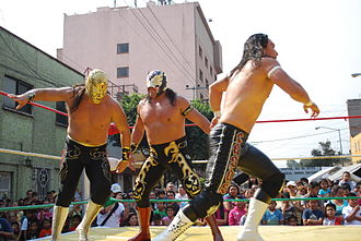 Último Guerrero - Último Guerrero with his son Taurus and Canelo Casas at an outdoor event.