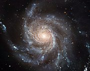 An example of a spiral galaxy, the Pinwheel Galaxy (also known as Messier 101 or NGC 5457)