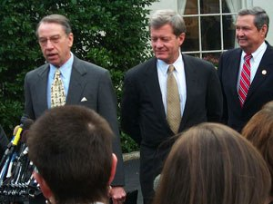 Chuck Grassley - Sen. Grassley, Sen. Max Baucus (D-MT), and Rep. E. Clay Shaw (R-FL) (left to right) address the media after a meeting at the White House with President Bill Clinton.
