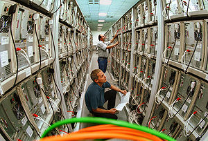Computer cluster - Technicians working on a large Linux cluster at the Chemnitz University of Technology, Germany