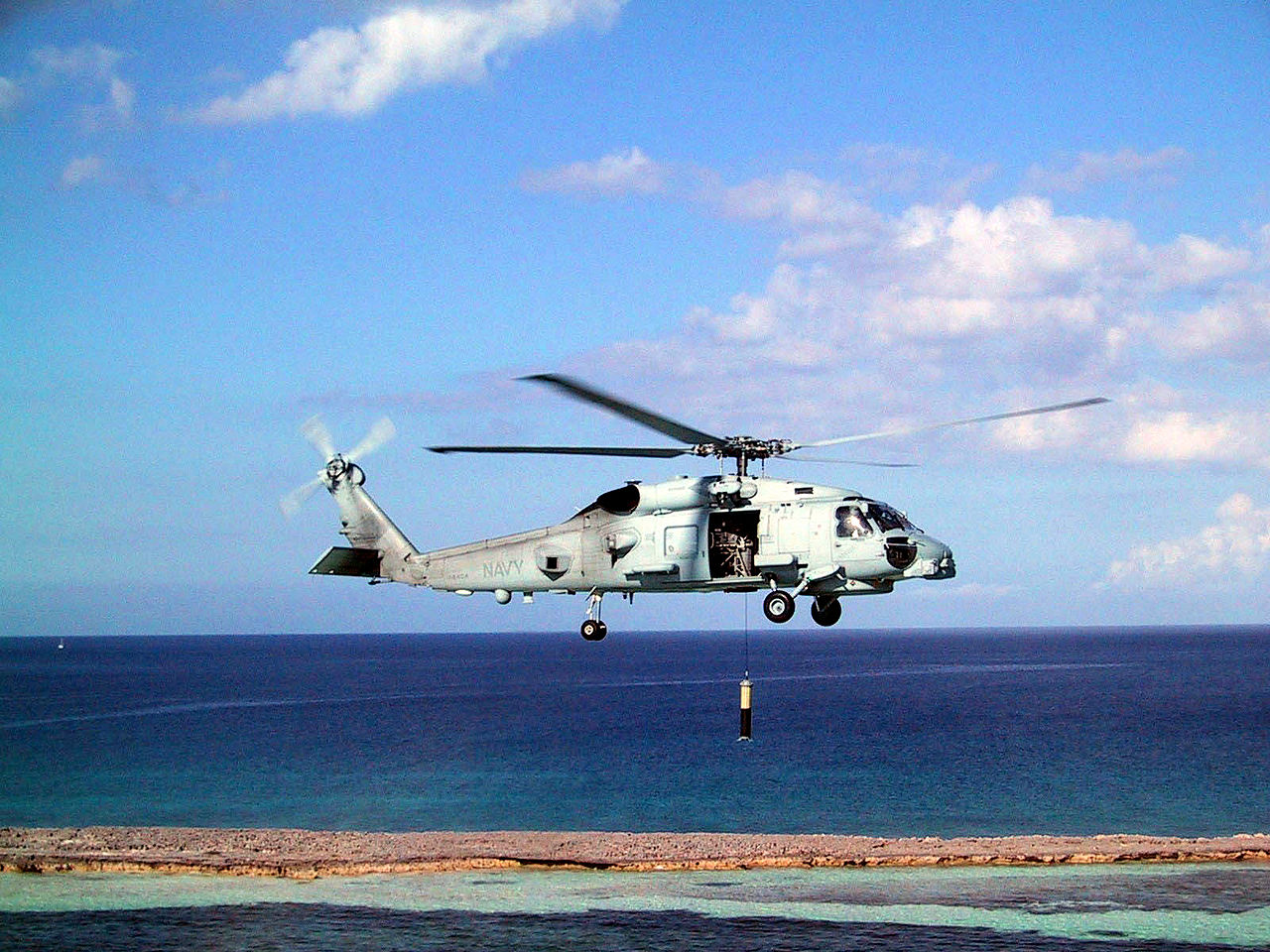 An MH-60R Seahawk conducts sonar operations.
