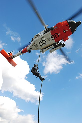 Maritime Safety and Security Team - A Maritime Safety and Security Team member conducts a vertical insertion from an HH-60 Jayhawk helicopter