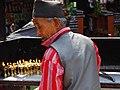 Man with Votive Candles - Thamel District - Kathmandu - Nepal (13422008333).jpg
