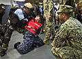 Members of the Indonesian special operations forces unit Kopaska simulate incapacitating a suspect while being observed by U.S. Navy Chief Boatswain's Mate Elias Inoa, right, assigned to Maritime Civil 130524-N-IY633-214.jpg