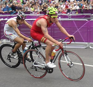 Colombia at the 2012 Summer Olympics - Carlos Quinchara, in white, during the triathlon.