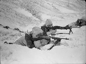 Royal Marines Division - Men of the Royal Marines Division training in deep snow at Hawick, Scotland during March 1942