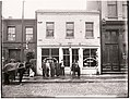 Men standing on the sidewalk in front of the Globe Shaving Parlor at 1015 Carr.jpg
