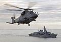 Merlin helicopter hovers over HMS Sutherland MOD 45147560.jpg