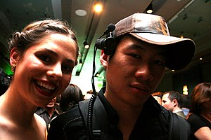 Lifecasting (video stream) - Entrepreneur and lifecaster Sarah Austin with Justin.tv founder Justin Kan in a photo by Brian Solis at DoubleClick's April 26, 2007 ad:tech party in San Francisco. Wearing the capcam, Kan was lifecasting at that event.