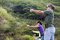 Military Spouses fire the Berretta M9 9mm Pistol during a family day event at Kaneohe Range, Marine Corps Base Hawaii, Kaneohe Bay on May 24, 2013 130524-M-BN443-034.jpg