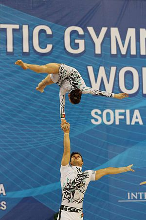 Acrobatic gymnastics - Mixed pair in one arm flag
