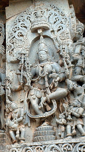 Mohini - A sculpture of an eight-armed dancing Mohini at the Hoysaleswara Temple in Halebidu.