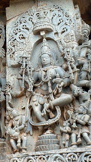 Mohini - A sculpture of an eight-armed dancing Mohini at the Hoysaleswara Temple in Halebidu.