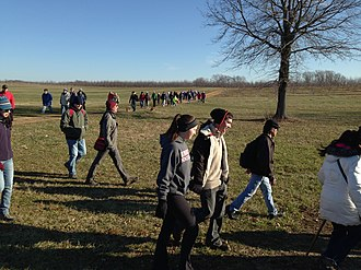 First Day Hikes - A group of First Day Hike participants in 2015 at Monmouth Battlefield State Park in New Jersey makes a turn after crossing an open field