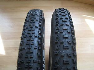 two mountain bike tires, same size (26, 2.1), ...