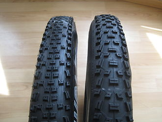 Tire - Two mountain bicycle tires with different tread patterns