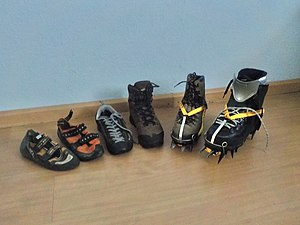 Mountaineering boot - fltr: two rock climbing shoes, aproach shoe, hiking boot, a leather mountaineering boot and a plastic mountaineering boot. The mountaineering boots are fitted with automatic crampons
