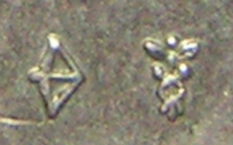 Mint mark - Privy mark (left) and mint mark on a Dutch coin. The mint mark is that of the mint of Utrecht. Since 1830 (with an interruption in 1941-1945) this mark is pressed on all Dutch coins.
