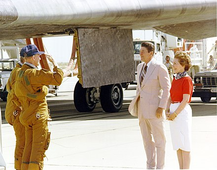 Columbia astronauts Thomas K. Mattingly and Pilot Henry Hartsfield salute President Ronald Reagan, standing beside his wife, Nancy, upon landing in 1982. NASA salutes Reagans.jpg