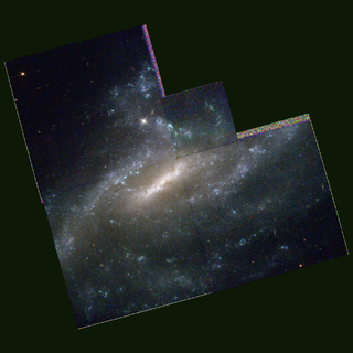 barred spiral galaxy in the constellation Canes Venatici