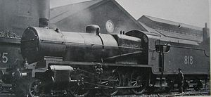 """SECR N class - Despite being in Southern Railway ownership, No. 818 still featured the SECR dark grey livery in 1924. Note the """"stovepipe"""" chimney, and the absence of a piston tail-rod on the cylinder front."""