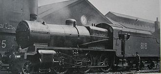 "SECR N class - Despite being in Southern Railway ownership, No. 818 still featured the SECR dark grey livery in 1924. Note the ""stovepipe"" chimney, and the absence of a piston tail-rod on the cylinder front."