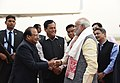 Narendra Modi being seen off by the Governor of Assam, Shri Jagdish Mukhi and the Chief Minister of Assam, Shri Sarbananda Sonowal, as he emplanes for New Delhi from Guwahati, after the visit to Mizoram and Meghalaya.jpg