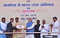 """Narendra Modi presenting the credit certificates, under various schemes to the beneficiaries from Scheduled Casts, at the launching ceremony of the """"Gram Uday se Bharat Uday"""" Abhiyan, in Mhow, Madhya Pradesh.jpg"""