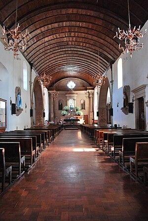 Santa Clara del Cobre - Parish church with copper chandeliers and wall decorations