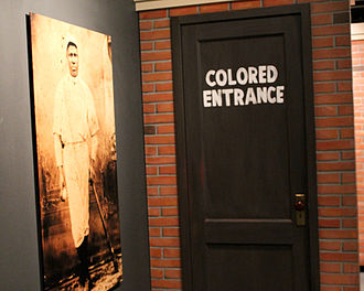 Josh Gibson - Negro league baseball exhibit featuring Gibson's portrait at the Baseball Hall of Fame