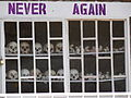 Never Again - With Display of Skulls of Victims - Courtyard of Genocide Memorial Church - Karongi-Kibuye - Western Rwanda - 02.jpg