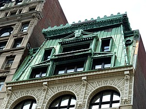 New Era Building (New York City) - Detail of copper-front mansard roof and sixth-story iron ornamentation