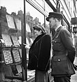 Newly-engaged Marcelle Lestrange and her fiance Flying Officer Harold Lackland Bevan looking for a suitable engagement and wedding ring in London during March 1943. D12847.jpg