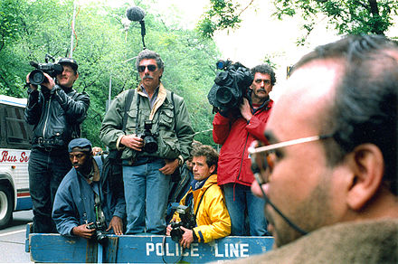News photographers and reporters waiting behind a police line in New York City, in May 1994 News photographers and reporters wait outside Jacqueline Kennedy Onassis' apartment.jpg