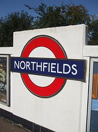 Northfields station roundel.JPG