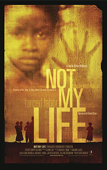 "The words ""NOT MY LIFE"" in light yellow superimposed on a darker yellow background with the face of a child peering over the words"