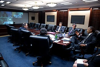NATO Quint - Barack Obama, Matteo Renzi, David Cameron and  Francois Hollande participating in a video teleconference.