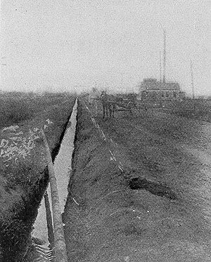 Texas oil boom - Oil flowing through an open ditch in Texas, 1911