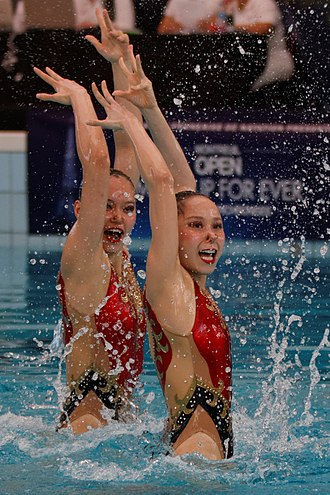 Synchronised swimming - Wu Yiwen and Huang Xuechen of China perform during the duet technical routine at the 2013 French Open.