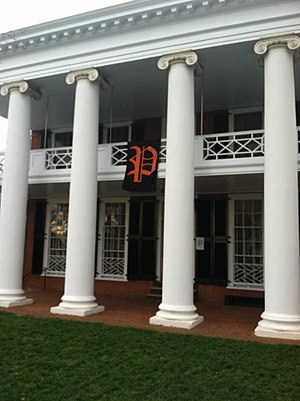 "Secret societies at the University of Virginia - A banner with a scripted ""P"", representing the P.U.M.P.K.I.N. Society, hangs from a pavilion at the University of Virginia."