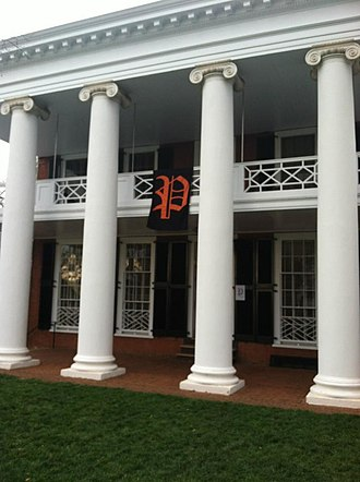 """Secret societies at the University of Virginia - A banner with a scripted """"P"""", representing the P.U.M.P.K.I.N. Society, hangs from a pavilion at the University of Virginia."""