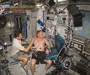 Michael Fincke - Gennady Padalka performs an ultrasound exam on Fincke during Expedition 9