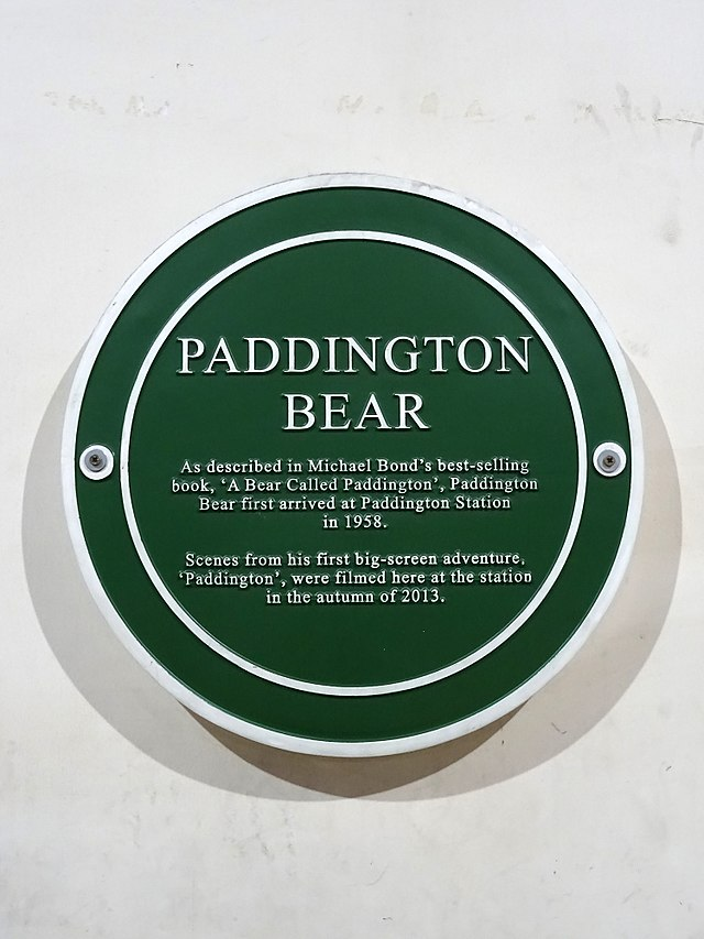 Green plaque № 49080 - Paddington Bear As described in Michael Bond's best-selling book, 'A Bear Called Paddington', Paddington Bear first arrived at Paddington Station in 1958. Scenes from his first big-screen adventure 'Paddington. were filmed here at the station in the autumn of 2013.